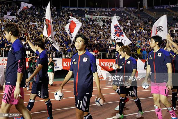 Kensuke Nagai of Japan and his teammates greet fans at a sendoff ceremony for the London 2012 Olympic Games after the international friendly match...