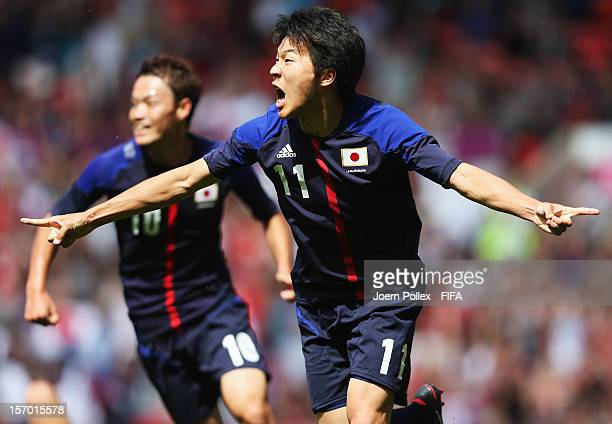 Kensuke Nagai of Japan celebrates after scoring his team's first goal during the Men's Football Quarter Final match between Japan and Egypt on Day 8...