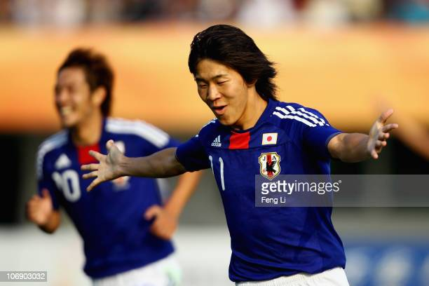 Kensuke Nagai of Japan celebrates first goal during a Men's 1/8 Final football match between Japan and India during day four of the 16th Asian Games...