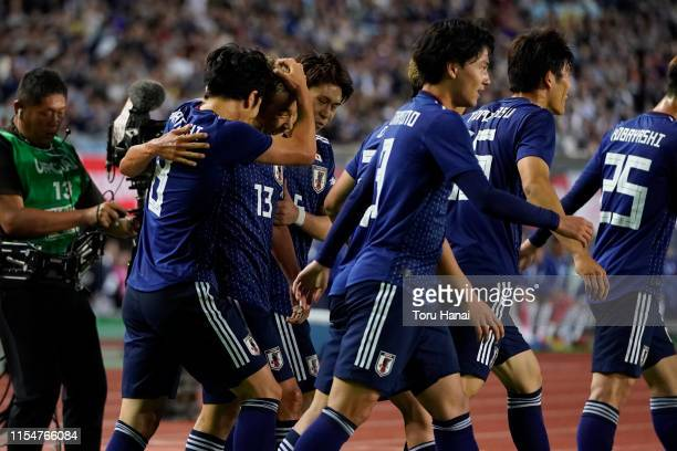 Kensuke Nagai of Japan celebrates with team mates after scoring a goal against El Salvador during the international friendly match between Japan and...