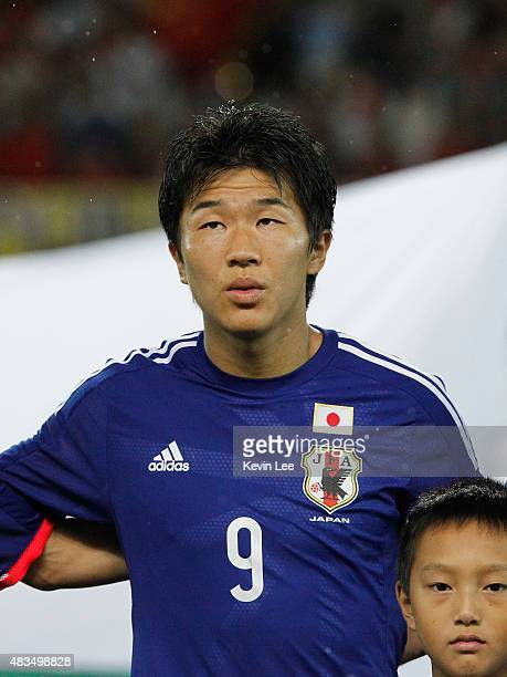 Kensuke Nagai of Japan stands on the field before the match against China during the EAFF East Asian Cup 2015 final round at the Wuhan Sports Center...