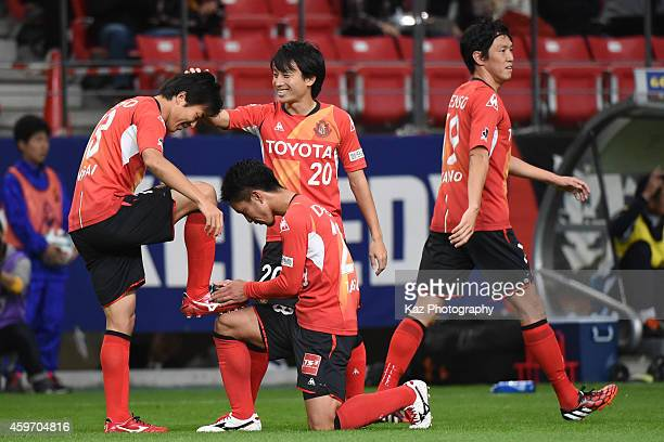 Kensuke Nagai of Nagoya Grampus celebrates his opening goal with teammatesTaishi Taguchi and Asahi Yada of Nagoya Grampus during the JLeague match...