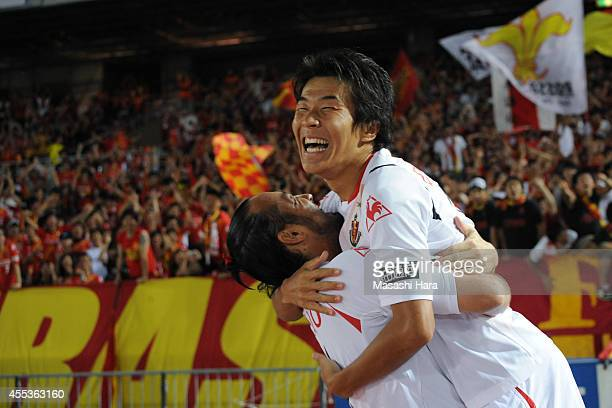 Kensuke Nagai of Nagoya Grampus celebrates the second goal with Marcus Tulio Tanaka during the JLeague match between Yokohama FMarinos and Nagoya...