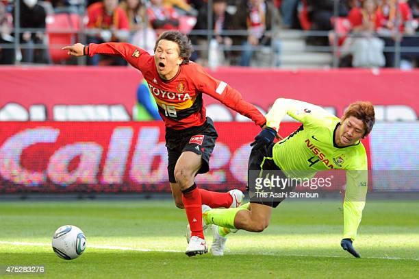 Kensuke Nagai of Nagoya Grampus is brought down by Yuzo Kurihara of Yokohama FMarinos to get a penalty during the JLeague match between Nagoya...