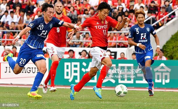 Kensuke Nagai of Nagoya Grampus runs with the ball to score his team's second goal during the JLeague match between Nagoya Grampus and Avispa Fukuoka...