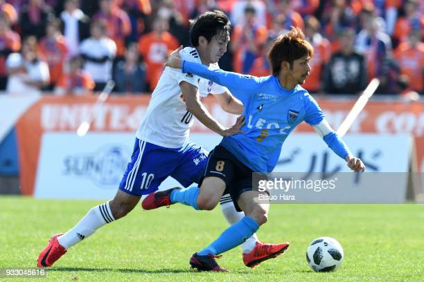 Kensuke Sato of Yokohama FC and Masaru Kato of Albirex Niigata compete for the ball during the JLeague J2 match between Yokohama FC and Albirex...