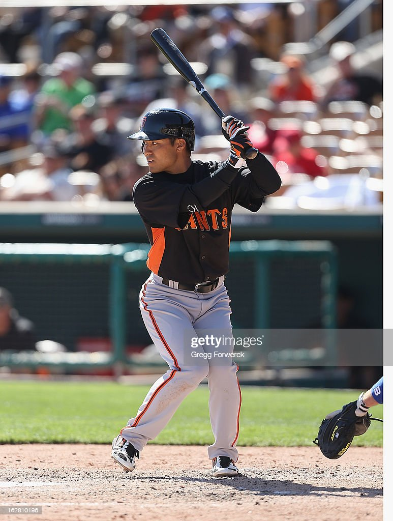 Kensuke Tanaka of the San Francisco Giants bats during a spring training baseball game against the Los Angeles Dodgers at Camelback Ranch on February 26, 2013 in Glendale, Arizona.