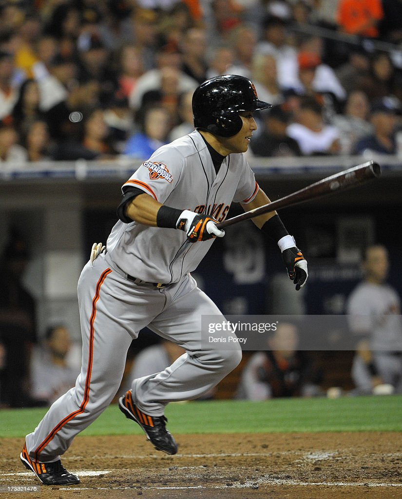 Kensuke Tanaka #37 of the San Francisco Giants hits an RBI single during the sixth inning of a baseball game against the San Diego Padres at Petco Park on July 11, 2013 in San Diego, California.