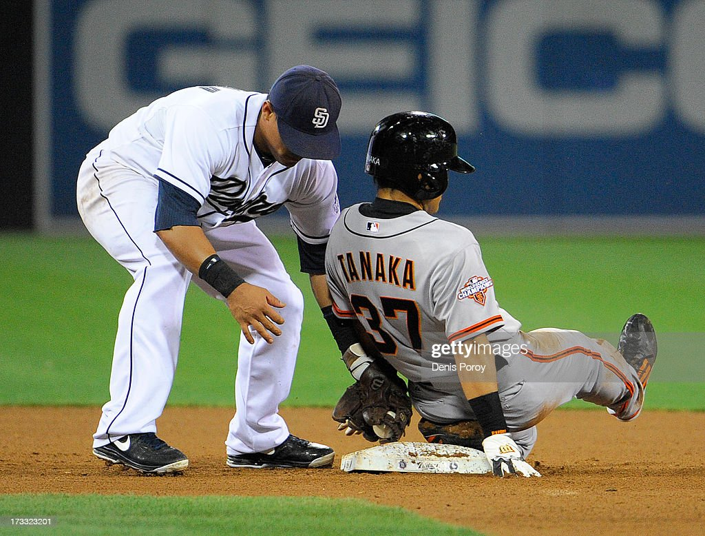 Kensuke Tanaka #37 of the San Francisco Giants steals second base in front of the tag of Everth Cabrera #2 of the San Diego Padres during the eighth inning of a baseball game at Petco Park on July 11, 2013 in San Diego, California.