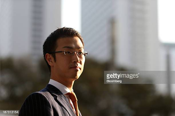 Kensuke Ueda a retail broker at Nomura Holdings Inc poses for a photograph in Tokyo Japan on Friday Nov 1 2013 For Ueda and his peers at firms...