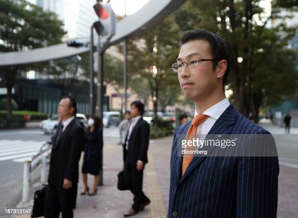 Kensuke Ueda a retail broker at Nomura Holdings Inc waits at a street crossing in Tokyo Japan on Friday Nov 1 2013 For Ueda and his peers at firms...