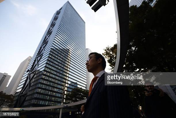 Kensuke Ueda a retail broker at Nomura Holdings Inc walks on a street in Tokyo Japan on Friday Nov 1 2013 For Ueda and his peers at firms including...