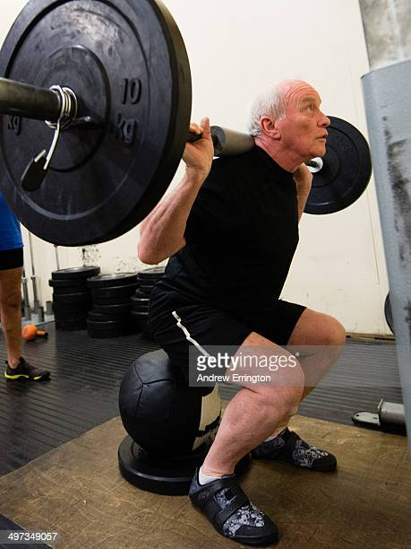 Kent and Sussex Crossfit gym Man 7080 years old lifting heavy weights