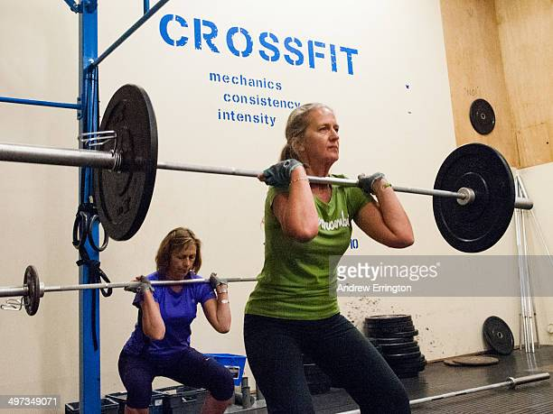 Kent and Sussex Crossfit gym Woman 6070years Woking out with weights