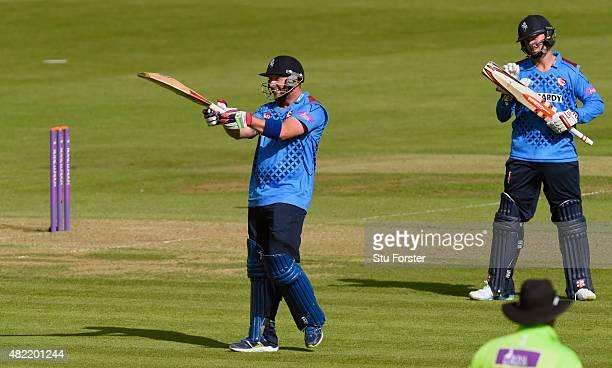 Kent batsman Darren Stevens raises his bat after reaching his century as partner Fabian Cowdrey applauds during the Royal London OneDay Cup match...