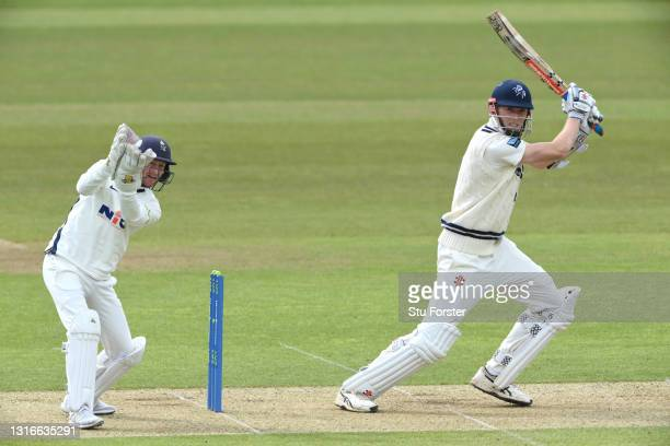 Kent batsman Zac Crawley drives a ball to the boundary as wicketkeeper Jonathan Tattersall looks on during day one of the LV= Insurance County...
