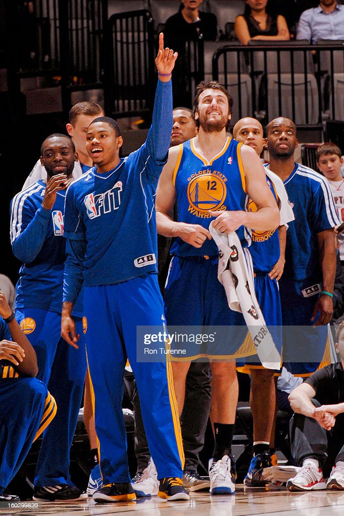 Kent Bazemore #20 and Andrew Bogut #12 of the Golden State Warriors celebrate from the sideline during a game against the Toronto Raptors on January 28, 2013 at the Air Canada Centre in Toronto, Ontario, Canada.