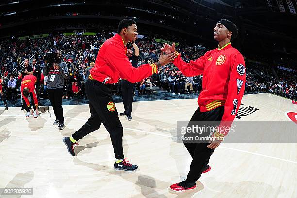 Kent Bazemore and Jeff Teague of the Atlanta Hawks shake hands before the game against the Portland Trail Blazers on December 21 2015 at Philips...