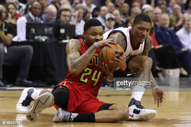 Kent Bazemore of the Atlanta Hawks and Bradley Beal of the Washington Wizards go after a loose ball in the first half in Game Five of the Eastern...