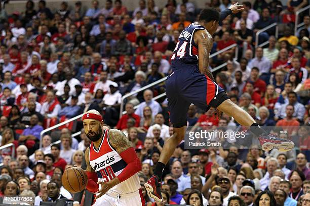 Kent Bazemore of the Atlanta Hawks attempts to block Drew Gooden of the Washington Wizards during the first half in Game Four of the Eastern...