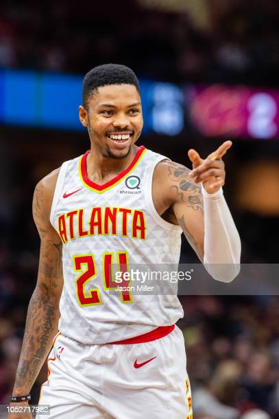 Kent Bazemore of the Atlanta Hawks celebrates after scoring against the Cleveland Cavaliers during the second half at Quicken Loans Arena on October...