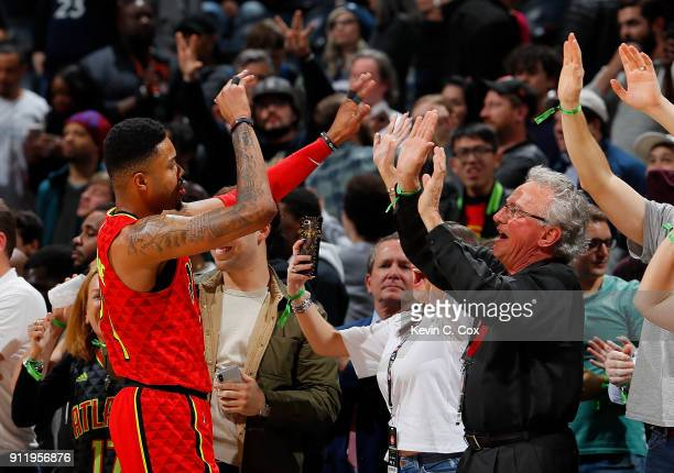 Kent Bazemore of the Atlanta Hawks celebrates with fans in the final seconds of their 105100 win over the Minnesota Timberwolves at Philips Arena on...