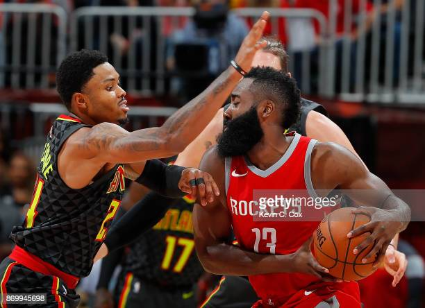 Kent Bazemore of the Atlanta Hawks defends against James Harden of the Houston Rockets at Philips Arena on November 3 2017 in Atlanta Georgia NOTE TO...