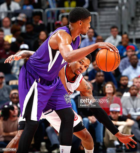 Kent Bazemore of the Atlanta Hawks defends against Rudy Gay of the Sacramento Kings at Philips Arena on March 9, 2015 in Atlanta, Georgia. NOTE TO...