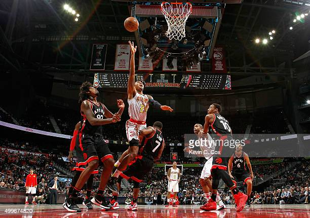 Kent Bazemore of the Atlanta Hawks drives against Kyle Lowry of the Toronto Raptors at Philips Arena on December 2 2015 in Atlanta Georgia NOTE TO...