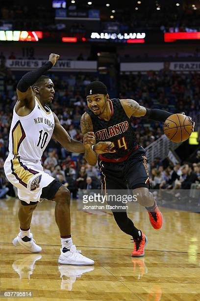 Kent Bazemore of the Atlanta Hawks drives against Langston Galloway of the New Orleans Pelicans during the first half of a game at the Smoothie King...