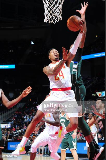 Kent Bazemore of the Atlanta Hawks drives to the basket against the Milwaukee Bucks on October 29 2017 at Philips Arena in Atlanta Georgia NOTE TO...