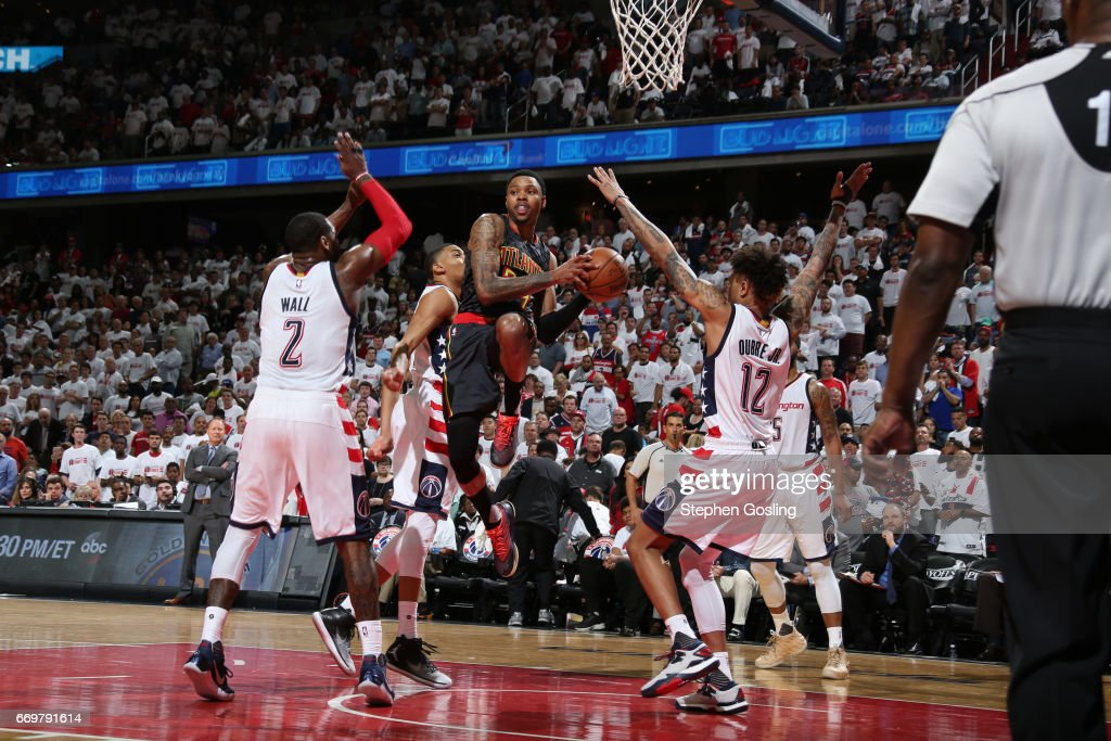Kent Bazemore #24 of the Atlanta Hawks drives to the basket and passes the ball during the Eastern Conference Quarterfinals game against the Washington Wizards during the 2017 NBA Playoffs on April 16, 2017 at Verizon Center in Washington, DC.