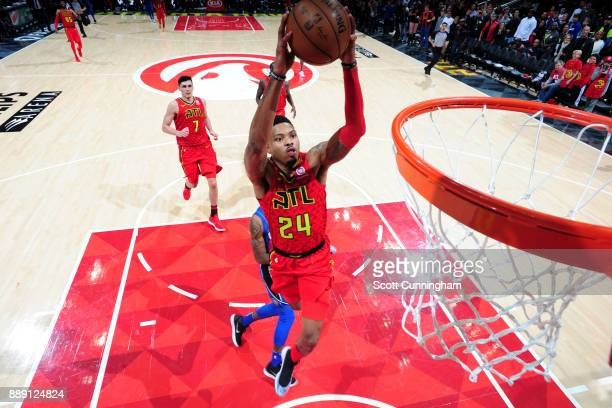 Kent Bazemore of the Atlanta Hawks dunks the ball against the Orlando Magic on December 9 2017 at Philips Arena in Atlanta Georgia NOTE TO USER User...