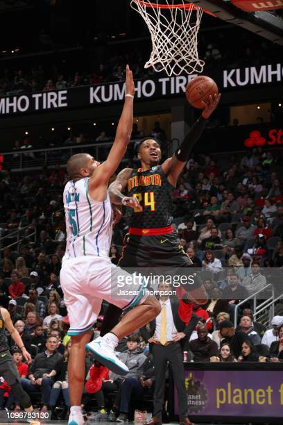 Kent Bazemore of the Atlanta Hawks goes to the basket against the Charlotte Hornets on February 9 2019 at State Farm Arena in Atlanta Georgia NOTE TO...