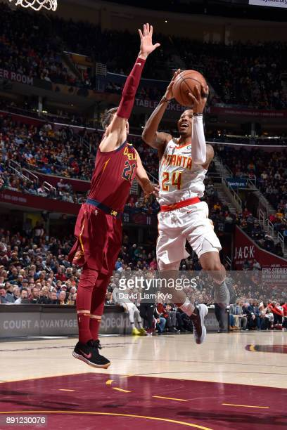 Kent Bazemore of the Atlanta Hawks goes to the basket against the Cleveland Cavaliers on December 12 2017 at Quicken Loans Arena in Cleveland Ohio...