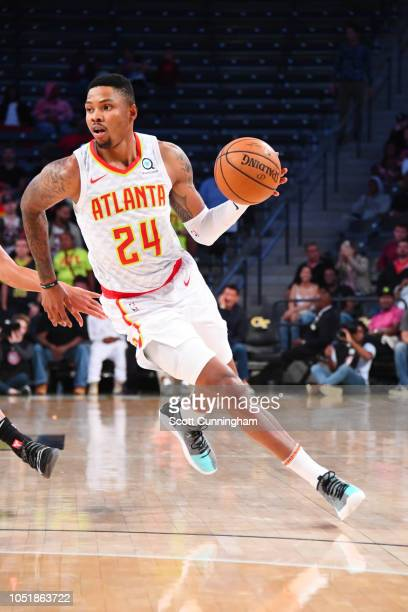 Kent Bazemore of the Atlanta Hawks handles the ball against the San Antonio Spurs during a preseason game on October 10 2018 at McCamish Pavilion in...