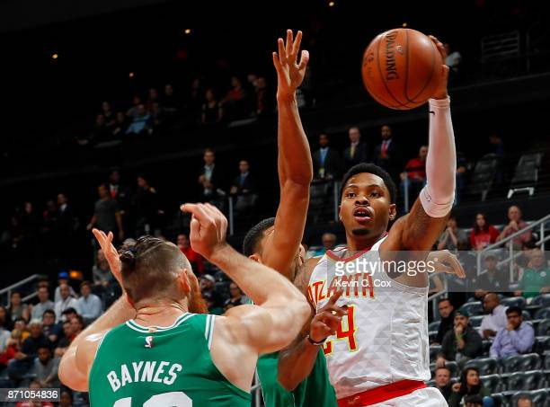 Kent Bazemore of the Atlanta Hawks looks to pass against Aron Baynes and Jayson Tatum of the Boston Celtics at Philips Arena on November 6 2017 in...