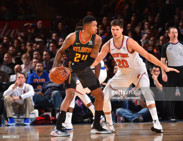 Kent Bazemore of the Atlanta Hawks looks to pass the ball against the New York Knicks at Madison Square Garden on December 10 2017 in New York New...