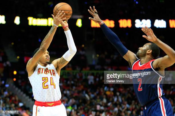Kent Bazemore of the Atlanta Hawks shoots a basket over John Wall of the Washington Wizards during the fourth quarter in Game Four of the Eastern...