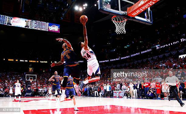 Kent Bazemore of the Atlanta Hawks shoots against JR Smith of the Cleveland Cavaliers in the second half during Game One of the Eastern Conference...