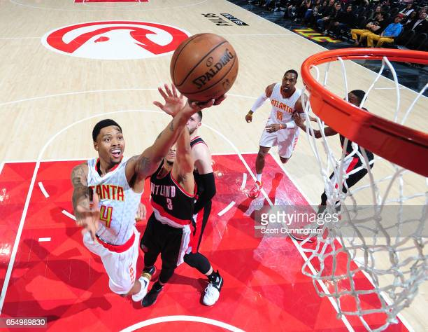 Kent Bazemore of the Atlanta Hawks shoots the ball against the Portland Trail Blazers during the game on March 18 2017 at Philips Arena in Atlanta...