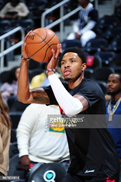 Kent Bazemore of the Atlanta Hawks shoots the ball during warmups before the game against the Milwaukee Bucks on October 29 2017 at Philips Arena in...