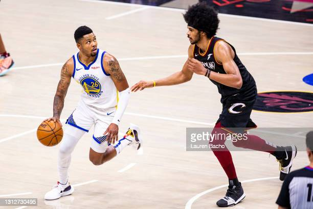 Kent Bazemore of the Golden State Warriors dribbles against Jarrett Allen of the Cleveland Cavaliers during the fourth quarter at Rocket Mortgage...