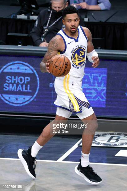 Kent Bazemore of the Golden State Warriors dribbles during the first half against the Brooklyn Nets at Barclays Center on December 22, 2020 in the...