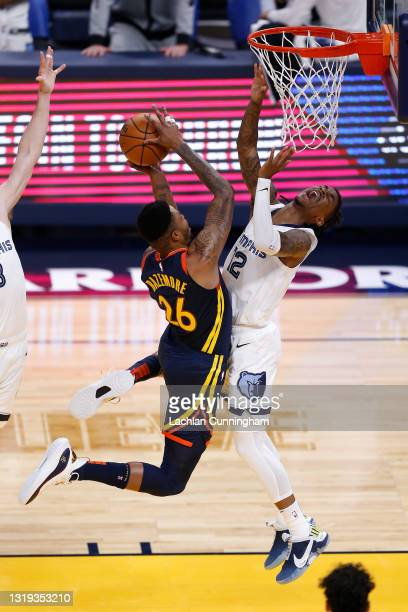 Kent Bazemore of the Golden State Warriors goes to the basket against Ja Morant of the Memphis Grizzlies in the second quarter of the NBA Play-In...
