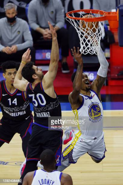 Kent Bazemore of the Golden State Warriors goes up for a shot as Furkan Korkmaz of the Philadelphia 76ers defends during the first period at Wells...