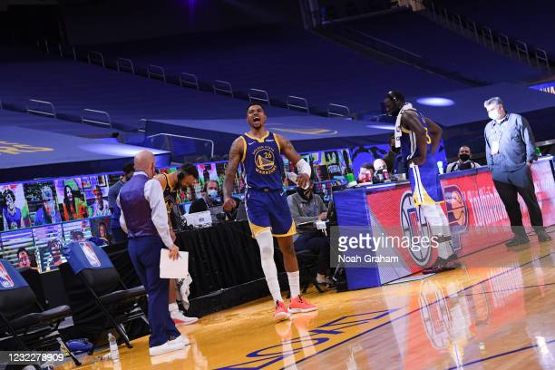 Kent Bazemore of the Golden State Warriors pours water on Stephen Curry after the game against the Denver Nuggets on April 12, 2021 at Chase Center...
