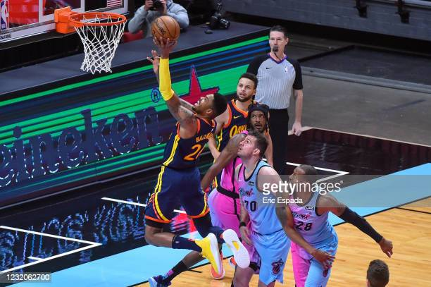 Kent Bazemore of the Golden State Warriors scores on a layup during the second half of the game against the Miami Heat at the American Airlines Arena...