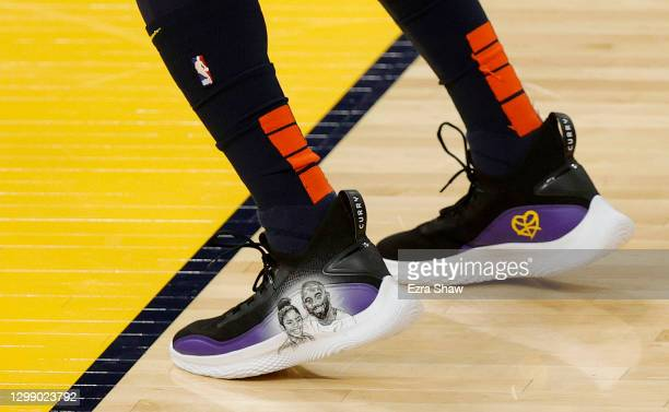 Kent Bazemore of the Golden State Warriors wears custom Under Armour sneakers with a picture of Kobe Bryant and his daughter, Gianna, on them during...