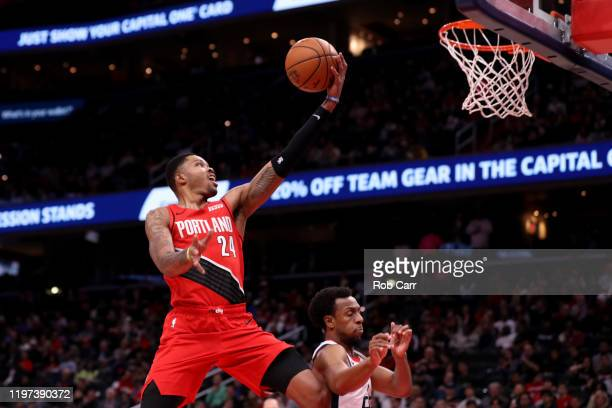 Kent Bazemore of the Portland Trail Blazers puts up a shot in front of Ish Smith of the Washington Wizards in the first half at Capital One Arena on...